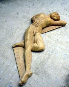 Resting figure (cast stone)